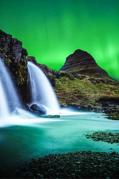 Kirkjufell, Snæfellsnes waterfall with the northern lights! 22 AMAZING Photos Of Iceland! These photos will put Iceland at the top of your bucket list! Click through to read the full post!