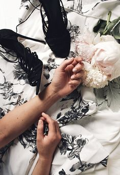 A monochrome floral dress and black heeled sandals, both from ASOS, and nude manicure by Paintbox