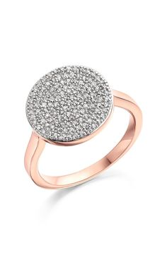 Obsessing over the polished disc that illuminates this statement-making ring made from polished precious metal.
