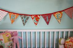 I am loving buntings - maybe fabric or hand-painted canvas flags of some sort...
