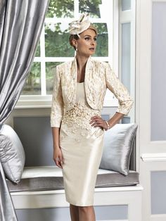 A fabulous Mother of the Bride & Mother of the Groom dress from the Portofino 2016 Collection by Ian Stuart London. This gold/platinum dress been designed using a silk dupion fabric and is embellished with metallic flowers. Paired with a matching jacket. Product code ISL667. View more Mother of the Bride / Groom dresses from our Ian Stuart collection at: http://www.baroqueboutique.co.uk/mother-of-the-bride-south-wales/ Photographs courtesy of: http://www.ianstuart-london.com/