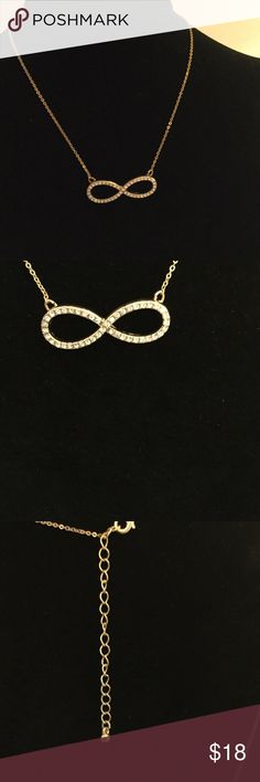 "ParkLane jewelry close outs The Infinity symbol with genuine Russian crystals, The chain is very fine gold tone.length is 18"" with a 3"" extender lobster claw clasp Park Lane Jewelry Necklaces"