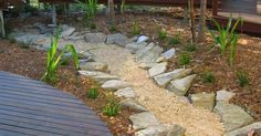 If you are having drainage problems in your backyard then a dry creek bed is just the idea to help fix that up! Even if you aren't having problems but just want to spruce up your yard, take a look at these great ideas to add an awesome feature to your yard! Straight A... #creek #creekbed #diy