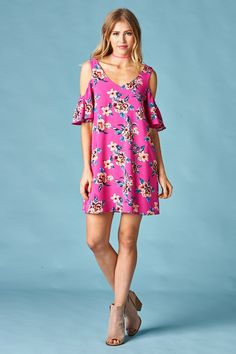 Hot pink floral cold shoulder tunic dress. Flutter sleeve, criss cross on top shoulders in back. True to size. Loving this color for spring & summer.