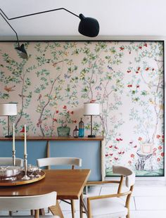 Full-Scale Wall Art: If a sunny, springtime feeling is what you're going for, check out this lovely space. That huge painted canvas is eye-catching, and the blue in the credenza really pops!