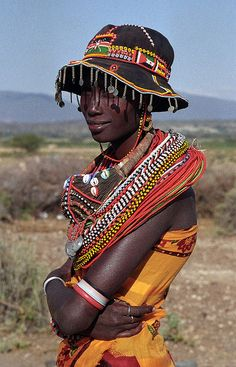 Tribe of Kenya Samburu woman. The Samburu are related to the Masai although they live just above the equator where the foothills of Mount Kenya merge into the northern desert and slightly south of Lake Turkana in the Rift Valley Province of Kenya.