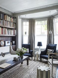 Stunning traditional living room in shades of gray with glam, metallic accents and classic cheeky London style.