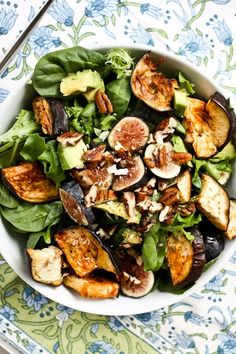 a leafy salad with olive oil, lavender salt, figs, eggplant, avocado and pecans