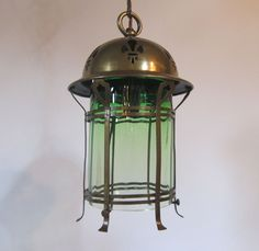 English lantern in the original brass finish complemented by replacement graduated green glass insert. c 1910  www.antiquelightingcompany.com