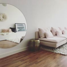 Preciously Me blog | Large round mirror and pink sofa Ikea soderhamn