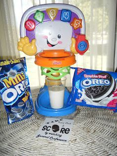 Pick one child to come up and choose a line to throw the oreo in the basket from.  (Put the basket on the table in front of them).  They get 3 tries to throw the cookie through the basket and DUNK it into the glass of milk.  If they make it, use the tongs to get it out and let them eat it. Yum!  Then sing the song in accordance to which line they made it from.  If they don't get it in 3 tries, let another child get a turn.