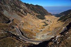 Transfagarasan Road in Romania. It's a zigzagging and hair pinning ride through the Fagaras Mountains...strap on tight!!