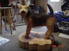 Tree Wood Carvings of Dogs   Here is an airdale dog that a client commissioned Eric to carve. It ...