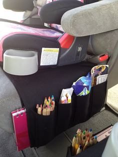 IKEA remote control holder turned into car organizer for kid stuff.