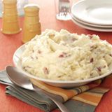 These creamy garlic mashed potatoes are so good, you can serve them plain—no butter or gravy is needed. Garlic Mashed Red Potatoes Recipe is shared by Valerie Mitchell of Olathe, Kansas.  Get Recipe > http://bit.ly/WKeaaL Pin Recipe > http://bit.ly/WKeaqY More Mashed Potatoes > http://bit.ly/WKeaqZ