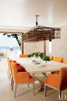 The dining table and chairs were designed by the studio | archdigest.com