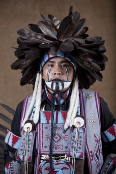 Northern traditional dancer Mario Lee, 22, of Del Muerto, Arizona, posing for a formal portrait during the 41st Annual Dine College Pow Wow in Tsaile, Arizona, United States, 2011, photograph by Diego James Robles.
