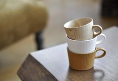 Gorgeous wooden and ceramic mugs from Helloneëst.