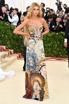 2018 met gala 8:17 p.m.: Stella Maxwell in the mother of all column dresses—one encrusted with images of the Madonna, in other words.