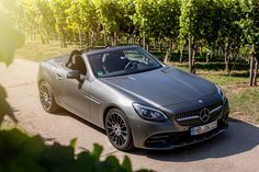Open-top driving pleasures with the Mercedes-AMG SLC Cabriolet. Photo by Christopher Busch (www.christopher-busch.com) for #MBsocialcar [Mercedes-AMG SLC 43 | Fuel consumption combined: 7.8 l/100km | combined CO₂ emissions: 178 g/km | http://mb4.me/efficiency_statement]