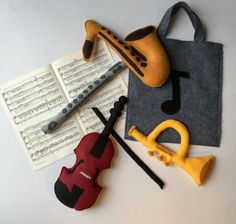 Toy Instruments for Pretend Play: plush, felt instruments and music bag by AtHeartShop on Etsy https://www.etsy.com/listing/256313426/toy-instruments-for-pretend-play-plush
