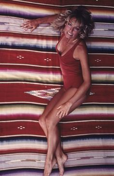 A rare shot of Farrah Fawcett's Red Bathing suit poster session.