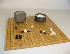 Ship FREE and remember, board games keep boredom at bay! Reversible Go Game Set With Bamboo Board, $119.95 (http://www.thegamesupply.com/go-game-set-with-bamboo-board/) #shipfree #bamboogoboardset
