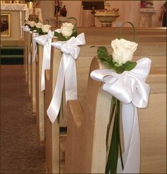Cream Rose aisle flowers with white ribbon