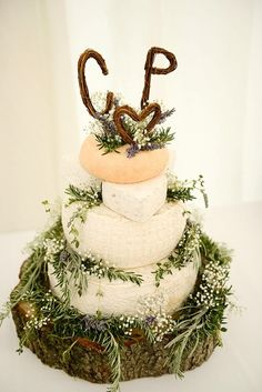 Wild and natural cheese wedding cake tower with garden grown herbs and willow cake topper