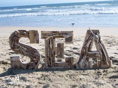 Love this....small pieces of drift wood and beach rocks glued to letters would be great for an ocean side balcony.