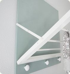 This DIY drying rack w/ pegs is just the thing for my basement laundry room.
