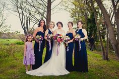 Navy blue mix and match bridesmaid dresses setting the tone for a bold outdoor wedding. Shop bridesmaid dresses on Brideside.com