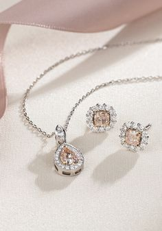 Pretty in pink! This one-of-a-kind pendant features a fancy light brownish-pink diamond framed by a halo of diamonds.