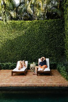Hang out poolside in the summer. An ivy colored wall creates privacy and a lush backdrop for lounging.