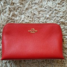 Coach make-up bag Almost a cherry red coach makeup bag with gold coach writing gently used cleaning through my closet Coach Bags Cosmetic Bags & Cases