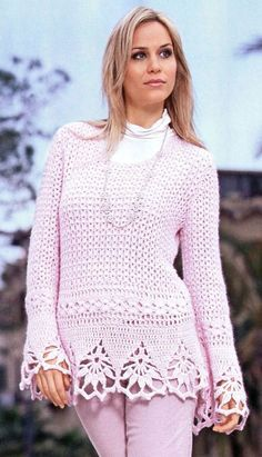 Pullover with lace edging.