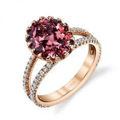 Dazzle the eye with this magical rose gold engagement ring! By Omi Privé it features a spectacular 3.80 ct. oval pink tourmaline securely held in place by sixteen pointed rose gold prongs and caressed by 64 colorless round diamonds on the split shank. Simply magnificent!  www.diamonds.pro