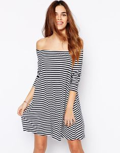 Long Sleeved swing dress with slashed neckline. Available in black & white stripe, Plain black and plain grey, by Glamorous.