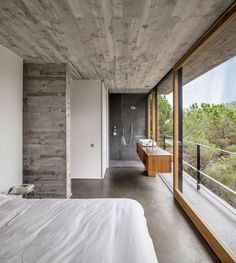 Home and Apartment, Magnificent Mediterranian House Design With Wood Frame For Glass Panel And Concrete Ceiling Design Also Minimalist Bed Decoration ~ Spectacular Contemporary Rustic Home to Blend with Raw Environment