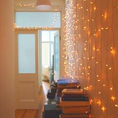 Waterfall lights: on a wall, hanging from lofted bed, over the window.