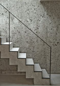 a Patchwork - Picture gallery - concrete stairs and wall with minimal metal handrail Concrete Staircase, Staircase Handrail, Interior Staircase, Floating Staircase, Stairs Architecture, Stair Railing, Staircases, Handrail Ideas, Architecture Design