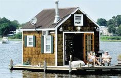 Donna Schaivone, and her husband, Sal, sit on the porch of their houseboat in New Haven Harbor on a fine day recently. Their view is always changing. (Arnold Gold/Register)