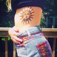 Sun tattoo #sun #tattoo okay I really like this tattoo and her shorts!