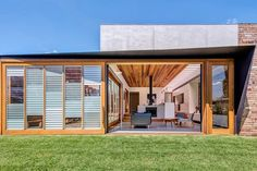 By sliding the north-facing door east, the living space is opened fully to the garden while enclosing and folding the pergola into the house.