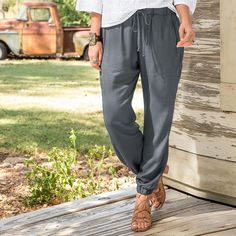 "EASY DAY PANTS -- These soft, easy-fit pants go the distance in comfort and style. Drawstring waist, elastic cuffed hem, zip pockets and slimming tonal side stripe. Rayon. Machine wash. Imported. Exclusive. Sizes XS (2), S (4 to 6), M (8 to 10), L (12 to 14), XL (16). 28"" inseam."