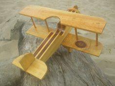 Brinquedo de Madeira - AviãozinhoAltura: 14.00 cm Largura: 30.00 cm Comprimento: 31.00 cm