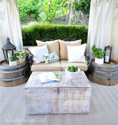 15 Outdoor Furniture Inspiration: love these barrel tables with lanterns. would add plexi glass or glass to top of barrels and put seashells under the glass.