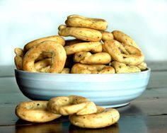 Taralli, a typical Southern Italian crunchy snack, kind of like a bread stick, but formed in the shape of a ring. They are simply made with flour, olive oil and wine, and flavored with various spic…