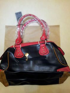 BEAUTIFUL STYLISH RED BAG! Absolutely beautiful shocking Red bag with gold studs at the bottom to place the bag upright, two strong handles linked with Gold ring to enhance its beauty with a thick red strap also included to adjust the length of the bag!  MUST NOT MISS THIS OPPORTUNITY!
