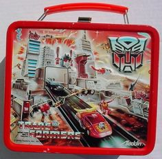 A classic Aladdin lunchbox featuring the catalog art / illustration for Hasbro's 1986 line of Transformers toys